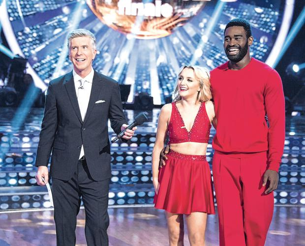 Talent: Evanna Lynch on 'Dancing with the Stars' with presenter (left) Tom Bergeron and dance partner Keo Motsepe. Photo: ABC/getty images