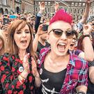 Carly Moffitt and her partner Jennifer Cleary from Dublin celebrate after the announcing the reults of same- sex marriage referendum at Dublin Castle. Pic: Mark Condren