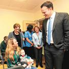 Health in focus: Taoiseach Leo Varadkar meets Kate Brady and Tom Brady (five months), from Castleknock, after he officially opened the Acute Stroke Unit at Connolly Hospital yesterday. Photo: RollingNews.ie