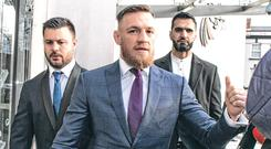 Main attraction: Conor McGregor arrives at the Criminal Courts of Justice. Photo: Kyran O'Brien