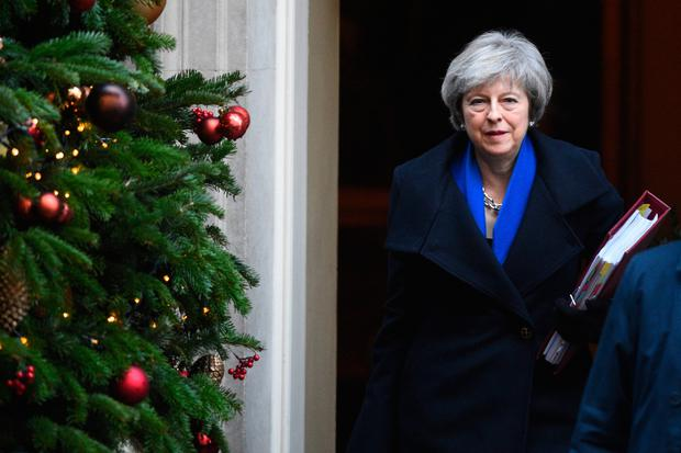 Glum: The Christmas tree may be up at Downing Street but there's precious little festive cheer for Prime Minister Theresa May. Photo: PA