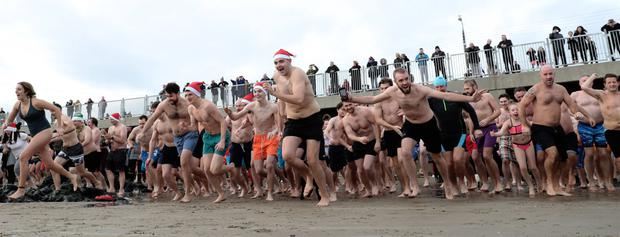 Everybody in: There was a full-blooded charge for the water at yesterday's charity swim at Portmarnock Beach, Co Dublin. PHOTO: Maxpix