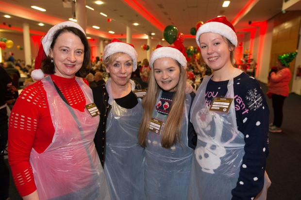 Christmas cheer: Sisters Ruth and Anne O'Connor, Shauna McGuinness and Mai Withoff help out at the annual Knights of Columbanus Christmas dinner at the RDS, Dublin. Photo: Mark Condren