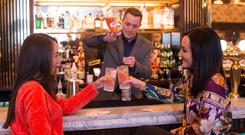 Tipple: Peter O'Connor making pink gin and tonics at Cafe en Seine on Dawson St, Dublin. Photo: Mark Condren