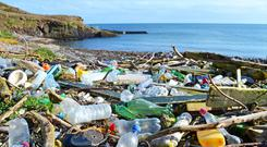 Plastic bottles and other rubbish washed up in Co Cork. Photo: Education Images/UIG via Getty Images