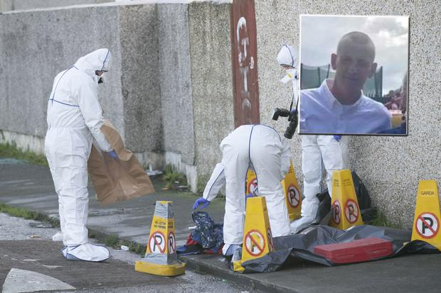 A Garda Technical Team at the scene of the fatal shooting in Darndale Inset: Victim John Lawless