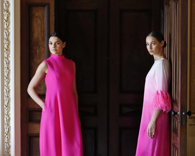 Classic colour: Pink 'Yana' wool crepe dress and pink 'Estelle' feather dress.