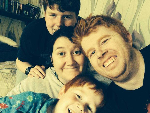 'Not going to be a next year': Tina Potts (40) with sons Philip (19) and Elliott (10) and partner Jonathan Harris, who she will wed this month