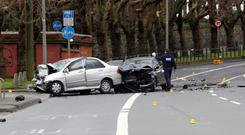 Fatal collision: A garda at the scene of the crash at Drumcondra Road Lower in Dublin early yesterday. Photo: Gareth Chaney/Collins