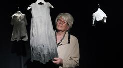 Survivor: Diane Croghan, who stayed in a Magdalene Laundry, views some of the items on exhibit at the National Museum of Ireland in Collins Barracks. Photo: Julian Behal