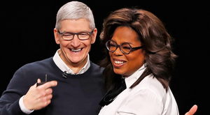 Star quality: Apple chief executive Tim Cook with Oprah Winfrey. Photo: Reuters