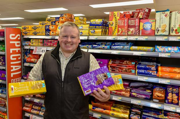 Stockpile: Shopkeeper Edward Coyle with some of the supplies he had stored ahead of Brexit.