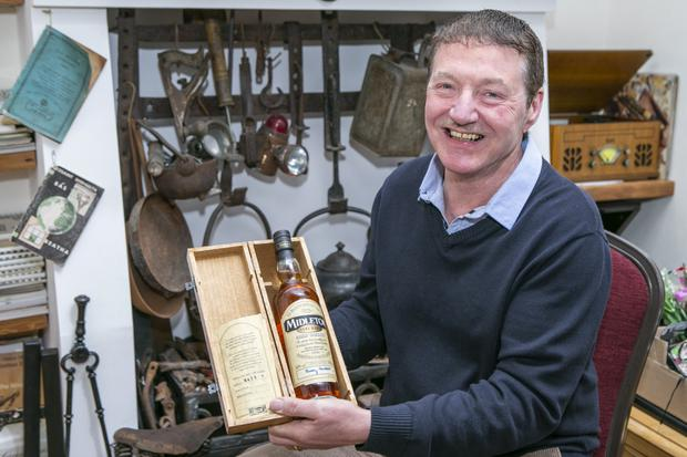 Spirited times: Eamonn Walsh with his bottle of Midleton Irish whiskey at his home in Tallaght. Photo: Kyran O'Brien