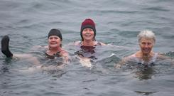 Unseasonal dip: Margaret Fitzgibbon, Ann McCourt and Miriam McGovern swim in the Forty Foot at Sandycove, Co Dublin. Photo: Damien Eagers