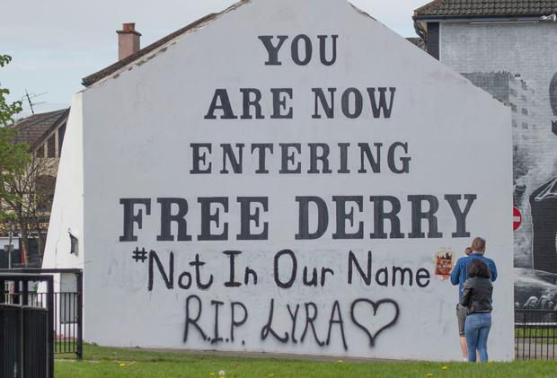 A message of condolence for 29-year-old journalist Lyra McKee which has been graffittied on to the Free Derry Corner. Photo: Joe Boland/PA Wire