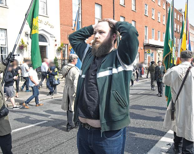 A lone objector staged his own peaceful protest against the Saoradh march in Dublin on Saturday. PHOTO: TONY GAVIN
