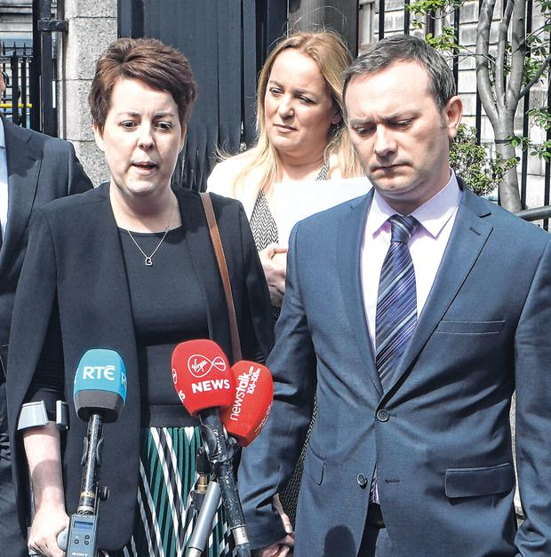 Fighter: Ruth Morrissey and her husband Paul speaking to the media on leaving the Four Courts after a High Court judgment yesterday. Photo: Collins