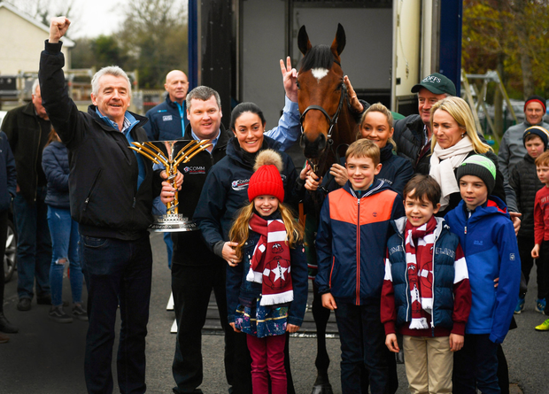 FAMILY GUY: Michael and Anita O'Leary, with their four children, horse trainer Gordon Elliott and grooms Karen Morgan and Louise Dunne escort 2019 Aintree Grand National winner Tiger Roll through Summerhill, Co Meath. Photo: Harry Murphy/Sportsfile
