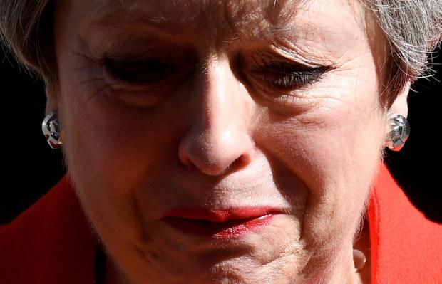 Emotional: British Prime Minister Theresa May reacts as she delivers her statement. Photo: REUTERS/Toby Melville/TPX IMAGES