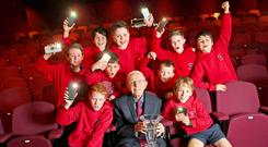 Blogger Florence McGillicuddy (95) with some of the boys from Ballyroan Boys' School in Dublin