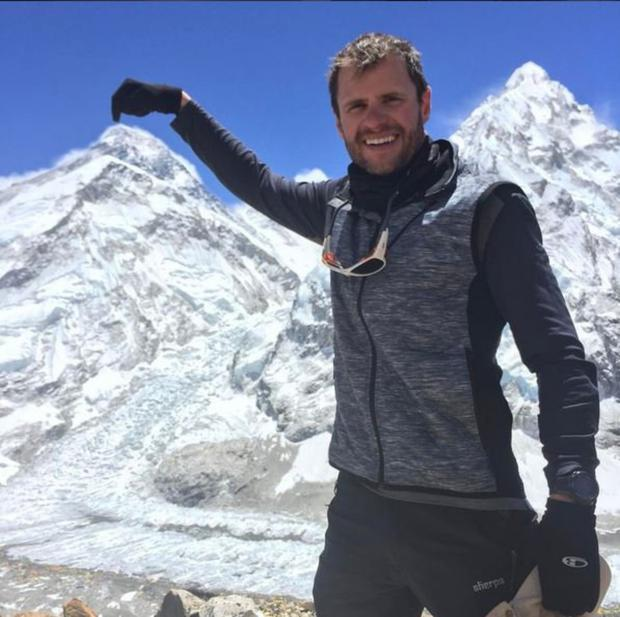 En route: John Burke points out the summit of Everest as seen from Pumori High camp in May 2017. Photo John Burke Instagram