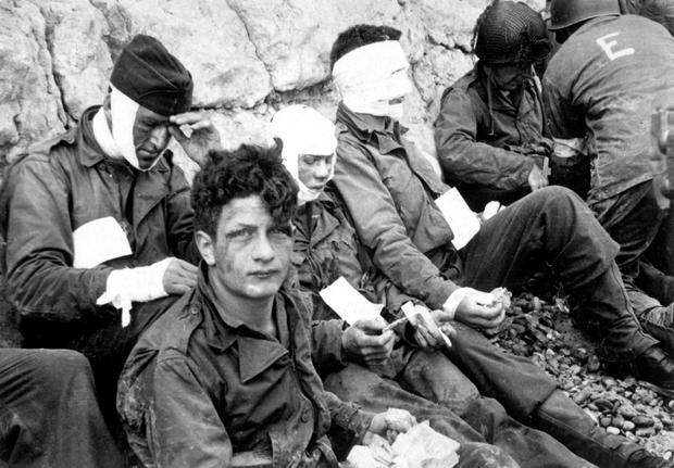 Injured Allied troops in a field hospital near Omaha Beach on D-Day