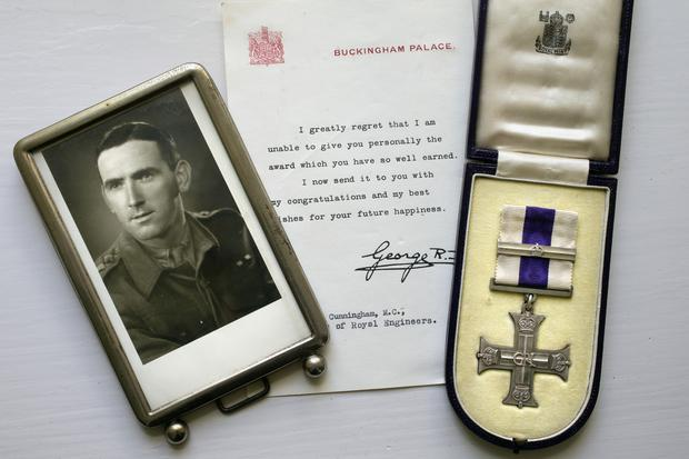 A photo of Redmond Cunningham (above) alongside a letter from King George VI and Redmond's Military Cross medal.