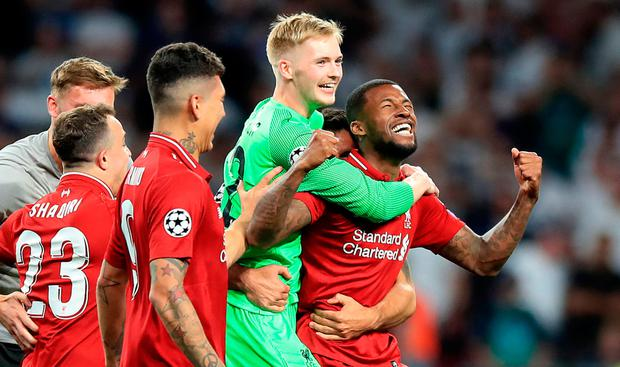 Caoimhin Kelleher celebrates with Liverpool players on Saturday night before linking up with the Irish U21s for yesterday's Toulon Tournament win over China