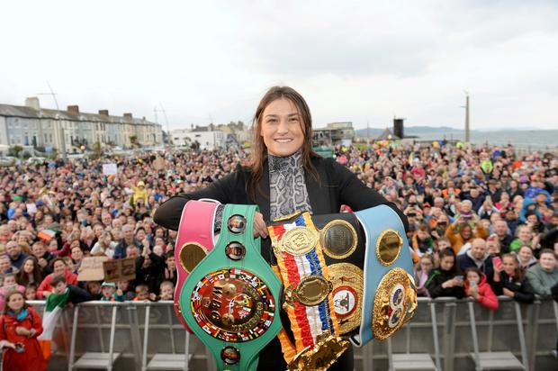 People's champ: Katie Taylor with all her belts on stage in front of crowds at her Bray homecoming celebrations. Photos: Caroline Quinn
