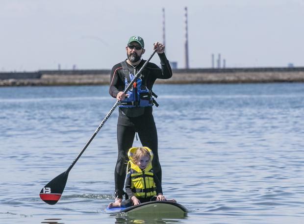 Aaron Daly with his Daughter Suin Daly (6) Dun Laoghaire enjoying a lazy day at the Forty Foot in Sandycove.