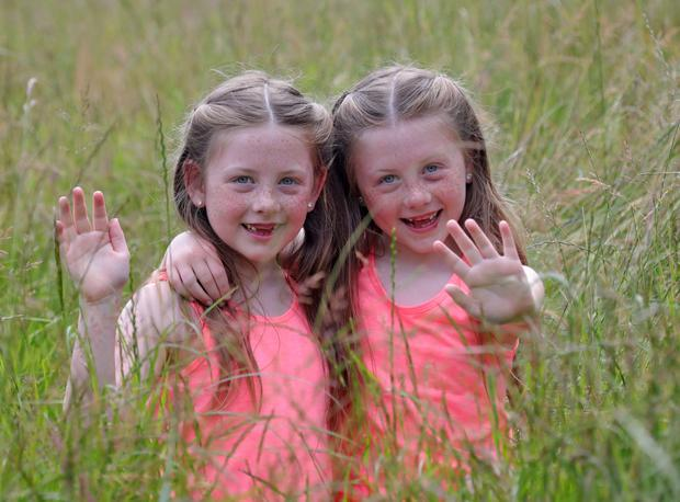 Relaxing: In the Phoenix Park seven-year-old twins Mya (left) and Cassie Keogh, from Inchicore. Photos: Colin Keegan, Collins