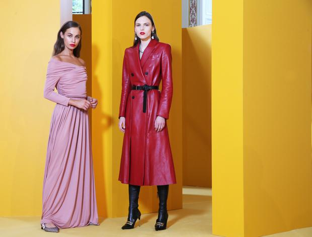 Thalia Heffernan wears Dior gown, €3,200 and Polina Sova wears Alexander McQueen red leather coat, €4,690