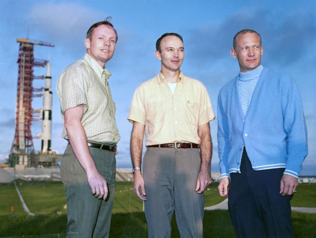 History makers: Apollo 11 astronauts Neil Armstrong, Michael Collins and Edwin 'Buzz' Aldrin with their Saturn V rocket in the background