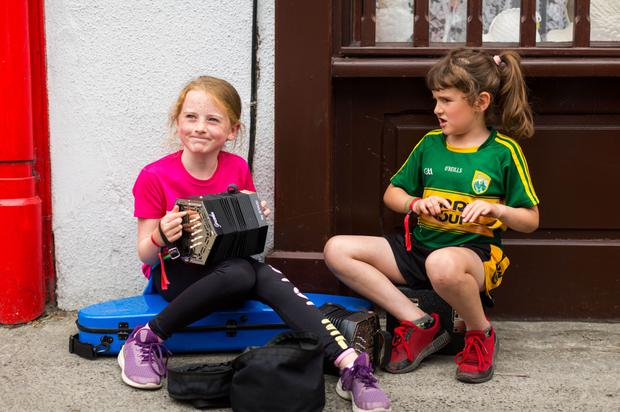Summer fun: Caoimhe Fitzpatrick (8), from Limerick, and Mary Walsh (7), from Co Kerry, at the Willie Clancy Summer School Festival in Miltown Malbay, Co Clare. Photo: Oisin McHugh/True Media