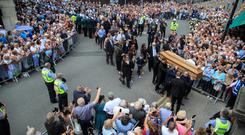 Goodbye to Grace: the procession winds through the Liberties in Dublin yesterday. Photo: Mark Condren