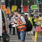 Making a point: Extinction Rebellion activists stop the traffic on Tara Street, Dublin. Photo: Conor Healy