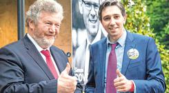 Hot seat: Former health minister James Reilly (left) and current incumbent Simon Harris. Photo: Colin O'Riordan