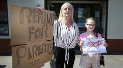 Protest: Tina Cassidy, with her grandchild, Cassie Connolly (9), outside the Hyde and Seek Crèche on Tolka Road in Dublin. Photo: Damien Eagers