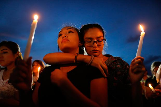 Grief: People attend a candlelight vigil for the victims of the mass shooting in El Paso, Texas