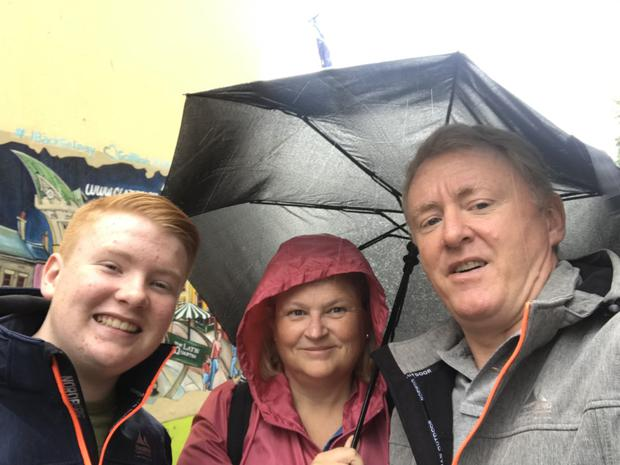 John Murray pictured with his wife Sheila and their son