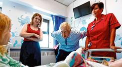 Charm offensive: Boris Johnson talks to patient Scarlett Gibbons (5) during a visit to the Royal Cornwall Hospital ahead of his call with Leo Varadkar. Photo: PA
