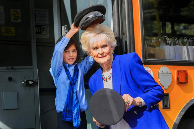Hats off: Mya Lynn (8), from Lucan, Dublin, and motor racing icon Rosemary Smith join forces. Photo: Collins Dublin, Gareth Chaney