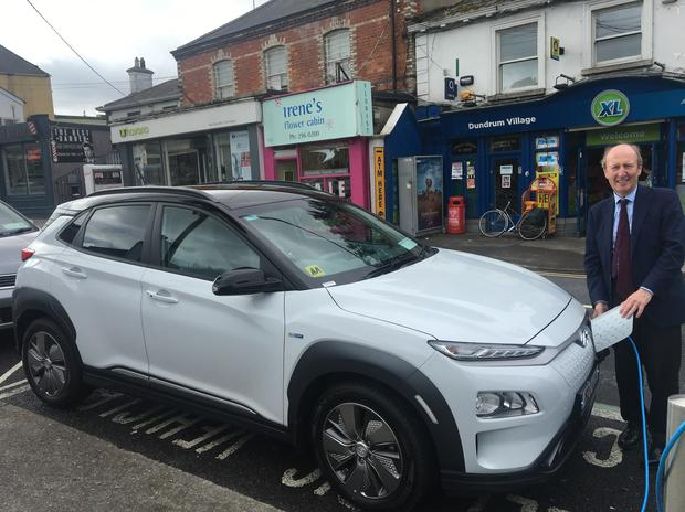 Plugging in: Shane Ross with his new Hyundai Kona EV on the streets of Dundrum in Dublin