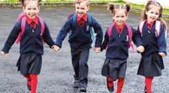 No worries: The quads on their way into Caherline National School. Photos: Press 22