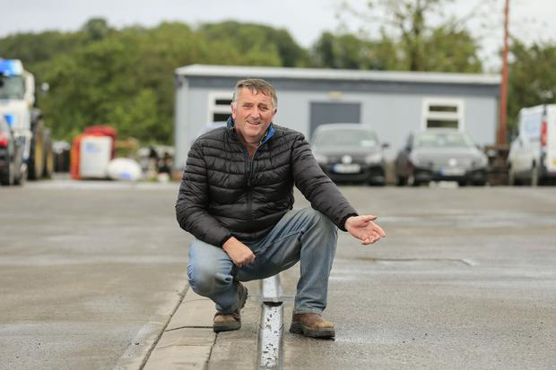 Dividing line: Garage owner Eamon Fitzpatrick stands on the border which divides the land on the forecourt. Picture by Gerry Mooney