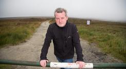 Making a difference: Ian Davis of the PURE Project in the Dublin/Wicklow mountains; and below, some of the illegal dumping. Picture by Mark Condren