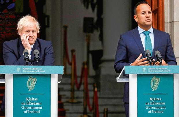 Meek: Boris Johnson and Leo Varadkar hold a news conference on the steps of Government Building yesterday. Photo: Reuters