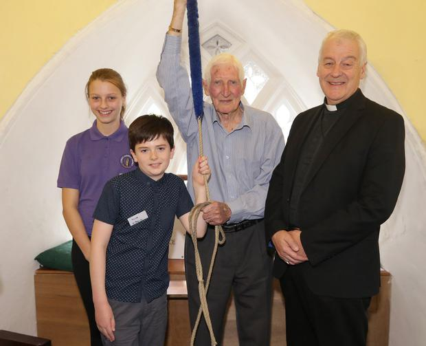 Sound man: Cyril Galbraith (95) with Jacob O'Rourke (10), Beulah Rowen (13) and Revd Michael Jackson at Christ Church Taney in Dundrum. Photo: Damien Eagers