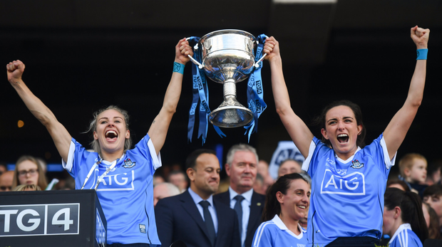 Nicole Owens, left, and Niamh McEvoy of Dublin lift the Brendan Martin cup at Croke Park last September. Photo by David Fitzgerald/Sportsfile