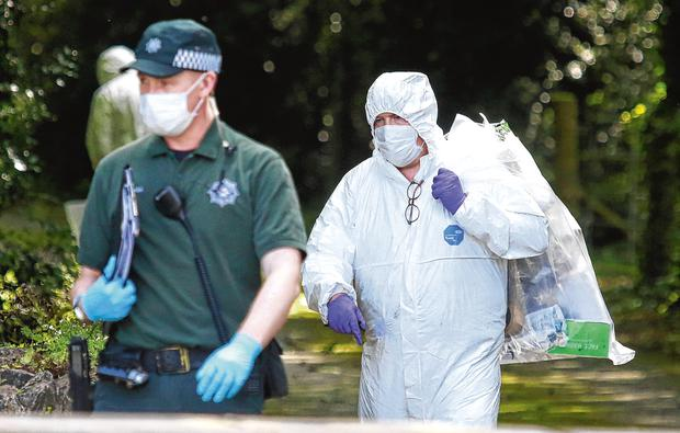 Members of the PSNI near a lane way leading to the home of Kevin Lunney in Kilnawley, Co Fermanagh, yesterday. Photo: Damien Eagers